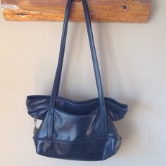 "The Original Stone Mountain Black Leather Handbag 15"" long 15"" tall. 5"" wide. Strap is 18"". Front zipper is the length of the bag. Inside small zipper. Logo on zipper. Stamped logo on bag. Beautiful soft leather. Non smoking home. Excellent condition. Stone Mountain Bags"