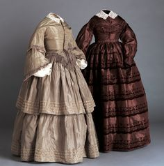 Left dress, early 1860s, American.  Silk taffeta and frings, cotton undersleeves and cotton lace collar.  Dar dress, 1865. American, silk taffeta with cotton lace collar.  www.arizonacostumeinstitute.com
