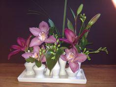 Adorable ceramic vase flower arrangement by Green Ambiance. www.greenambiancellc.com