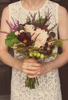 Brides.com: . A mixed bouquet of blush café au lait dahlias and spray roses, burgundy clematis, crab apples, and scabiosa pods, created by Ever Ours Events. www.MadamPaloozaEmporium.com www.facebook.com/MadamPalooza