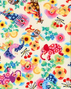 """The circus garden is full of blossom covered elephants, starry giraffes wearing striped socks, shy peacocks and winsome woodland creatures enjoying the cherries, blueberries, mushrooms and flowers flourishing around them. Larger animals are about 4 1/4"""", from the 'Yucachin' collection by Quilt Gate."""