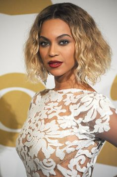 As much as we love a flowing mane on Bey, we thought this look from the 2014 Grammys was totally striking on the star: a shoulder-clearing wavy blond bob, paired with a statement lip and a statement eye. Who other than Queen B could pull this off?
