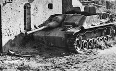 Forlorn and forgotten, a Sturmgeschütz (StuG IV) assault gun remains undisturbed where it was destroyed a year earlier in an unidentified French town. It would be many years before all the wrecks and debris were removed.