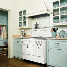 two-toned cabinets, painted inside to match, butcher block counters...love everything.