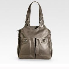 Marc by Marc Jacobs Teri tote Marc by Marc Jacobs Teri tote.  Small mark on outside pocket.   See last picture.  Great bag with three large compartments.   Deep pockets with signature turn locks.  Top zip closure.  Extra smaller pockets for cell phone.  Leather. Marc by Marc Jacobs Bags Totes