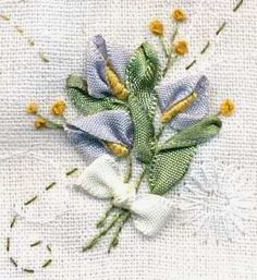 I ❤ ribbon embroidery . . . Calla lilies made with ribbon and bullion knots ~By maia felidae