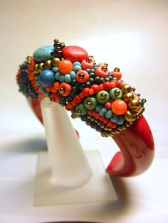 RED CORAL and TURQUOISE -- Beaded Gemstone on Wood Cuff Bracelet on Etsy, $45. Beadweaving #seedbeads