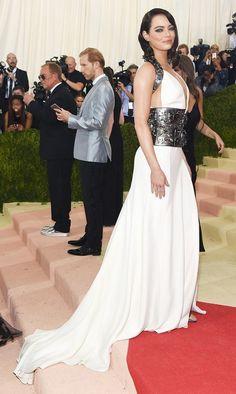 WHO: Emma Stone WEAR: Prada gown; Christian Louboutin heels.