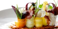 Romesco with Bellota ham, vegetables and radishes