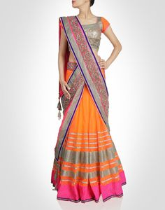 Orange lehenga layered over an inner sequined lining and sequinned blouse. Shop Now: www.kimaya.in