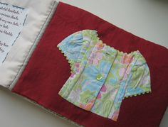 Recycled children's clothing book. This one's an amazing idea. I've got so many tiny adorable clothes of my son that I want to put in this :)