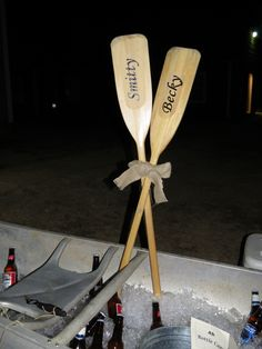 Our old metal canoe was set on top of hay bales outside the door and filled with ice and bottled drinks. Wooden oars, tied together with a burlap bow, had the bride and grooms names.