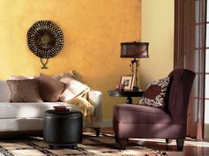 living room design with yellow paint and deep purple furniture