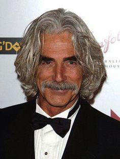Sam Elliott - long grey hairstyle and mustache - still my heart throb after all these years. Gorgeous, handsome just doesn't say enough; dang fine ass gorgeous! It may not be love but it's dang well lust at least  ; >