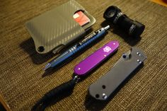 Kydex wallet, Schrade Tac pen, Swiss Cadet limited, Chris Reeves Sabenza, Armytech flashlight