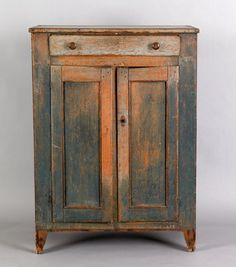 "Realized Price: $2574  Painted pine jelly cupboard, early 19th c., with single drawer and 2 cupboard doors, retaining an old blue/gray surface, 50 1/4"" h., 35 1/2"" w."