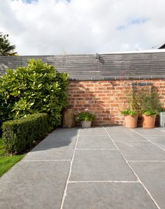 Worn Grey limestone has a rich and rustic charm, thanks to its antiqued and hand dressed edge finish.The grey palette of this stone makes it a fantastic stone for both internal and external applications, creating the popular infinity effect. Garden Slabs, Garden Tiles, Patio Tiles, Garden Paving, Patio Slabs, Driveway Tiles, Paving Stone Patio, Pool Pavers, Flagstone