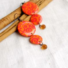 Sunny long yellow earrings with red spiral ornament  by OPStyle
