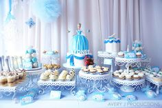 Love the curtain behind the cake table, the stands, and the hanging pompoms