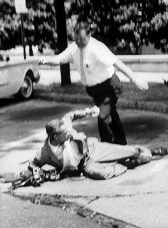 Cameraman being kicked by an unidentified man during a Freedom Rider Demonstration.