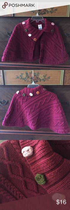 Cable knit Gymboree 7-8 buttoned cape/poncho Charming cape/poncho - my daughter outgrew it, but I've held onto it because I just adore it. 😉 Time for someone else to enjoy it now! Lightly worn. Cranberry-ish maroon color with buttons. Gymboree Shirts & Tops Sweaters
