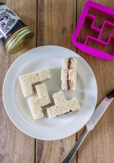 Bites and Pieces Sandwich Cutter. Your PBJ is super-fun to munch when it's cut into geometric shapes by this sandwich cutter by Fred! #pink #modcloth