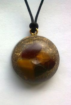 Small Orgone Pendant With Tiger Eye And Shungite Stone by TTDenim, £6.50