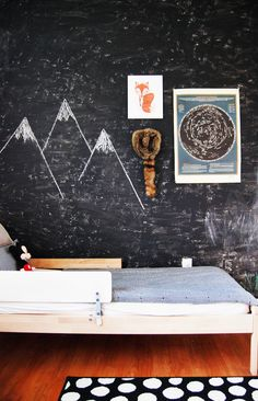 chalkboard wall and star map in boys' shared room