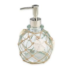 Nothing represents the ocean and all its majestic beauty better than seashells. To capture the essence of the beach, style your bathroom with the Sea Glass Lotion Dispenser from Avanti, featuring nautical rope and pretty starfish and shells.