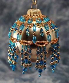 Lake blue and gold bauble cover.
