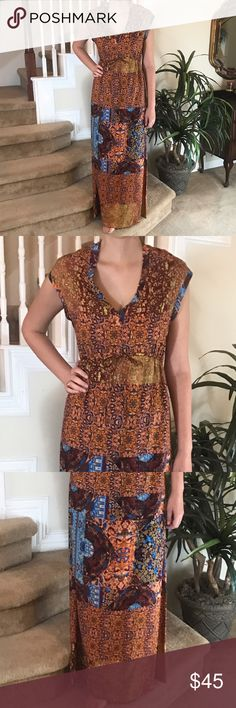 Griffin Paris Maxi This Griffin Maxi is stunning and features a tie at the waist, amazing print, 1/2 lined skirt and in perfect condition. Grifflin Paris Dresses Maxi