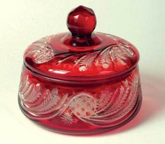 """Ruby Glass Covered Bowl    Intricately cut crystal flirts with the light with a motive to glisten. Perfect for dusting powder and puff or small necessities. 5""""."""