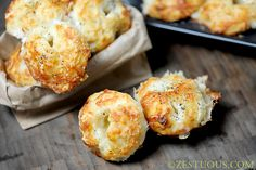 Cheesy Garlic Bites. Made with canned biscuits, mozzarella balls, butter, & more cheese. Looks easy and yummy!