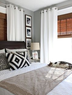 guest bedroom - allow guests to block out the light with a layered window treatment