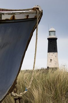 John Short Solid-Faced Canvas Print Wall Art Print entitled Abandoned Boat And Lighthouse, Humberside, England Derelict Buildings, Lighthouse Keeper, Lighthouse Art, Beacon Of Light, Foto Art, Am Meer, Abandoned Places, Abandoned Churches, Abandoned Asylums