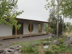 House RR is a minimal summer house located in Kvegerö, Sweden, designed by Norell/Rodhe. This summer house for a young couple and their two children acts as a wall along the perimeter of the plot. Rather than facing the view of the surrounding field, it focuses inwards, turning the small forested site into a world of its own.