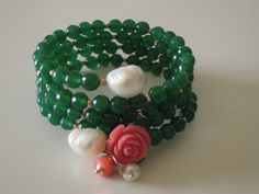 spiral silver bracelet in gold plated, jade stones and pearls.