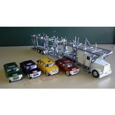 pThis Diecast Truck Auto Carrier and Car Hauler With four toy SUT having 132…