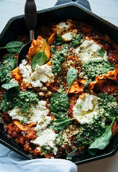 Vegan skillet lasagna with homemade almond ricotta and spinach walnut pesto. This hearty main is packed with vegetables and healthy- plant-based protein.