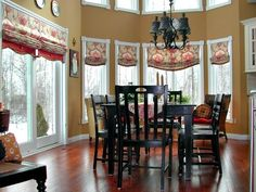 Roman shades can add color and punch when bold vibrant patterns are chosen.  #romanshades #boldfabric