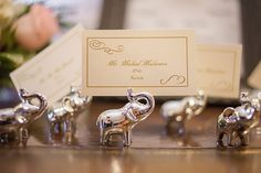 All of the tables were named after elephants at the David Sheldrick Wildlife Trust in Kenya. Each year for Valentine's day, Ian adopts an elephant from there for Courtney. Elephant decor can be spotted all over the room at Courtney & Ian's wedding. | A Winter Valentine's Day Wedding at Running Deer Golf Club