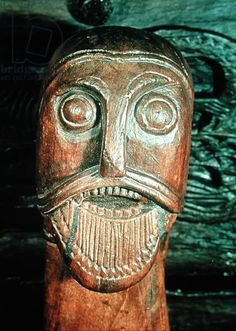 Detail of an ornamental head, from a sledge in the Oseburg burial (wood)