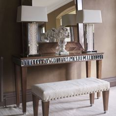 Mary Smith believes part of Simpsons' success lies in its combination of sparkling glass with beautiful wood finishes, such as the Charleston Tiffany console. Edged in Tiffany baguette mirror tiles, it is shown here in walnut but is also available in wenge and antique silver.
