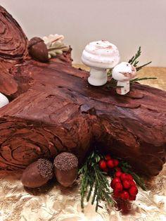 Hand-made Meringue Mushrooms and Chocolate Acorns decorate this traditional Bûche de Noël.