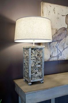 lamp filled with oyster shells, the table, the blue heron print, wall color... Love!
