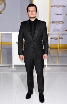 Josh Hutcherson (Peeta Mellark) kept things relatively simple in a gray suit, black shirt, and matching tie. Shiny black brogues and a little scruff completed his chic ensemble.