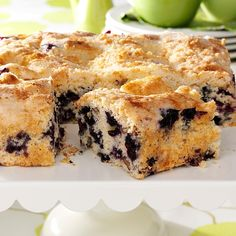 Blueberry Streusel Coffee Cake Recipe -This coffee cake smells wonderful as it bakes and tastes even better. The moist cake filled with juicy berries and crunchy pecans is a family favorite. It never lasts long at our house. —Lori Snedden, Sherman, Texas