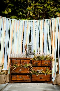 Streamer backdrop with decorated furniture. Photo by Mayfly Photography