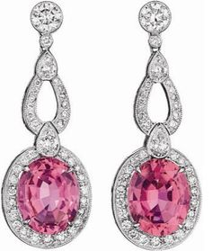 Each suspending an oval-cut pink tourmaline weighing approximately 6.71 carats in total, within a pavé-set diamond surround, from a pavé-set diamond fancy link accented by pear-shaped diamonds, to the collet-set circular-cut diamond surmount, mounted in platinum, length 1 1/2 inches.
