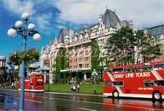 Go see Victoria in a double decker bus ...  This bus is parked outside the famous Empress Hotel.